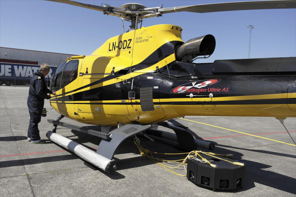Arild Solberg uses a helicopter to carry the Hasselblad rig, which he can control remotely.