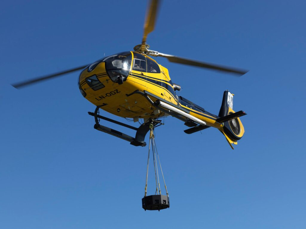 360aircam's custom-built Hasselblad medium format rig being carried by a helicopter
